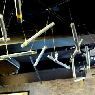 A hanging mobile of unexploded bombs above our heads.