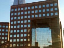 A building with an interesting shape located at the south end of London Bridge.