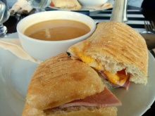 Parma ham, onion, brie and tomato panini with vegetable broth.