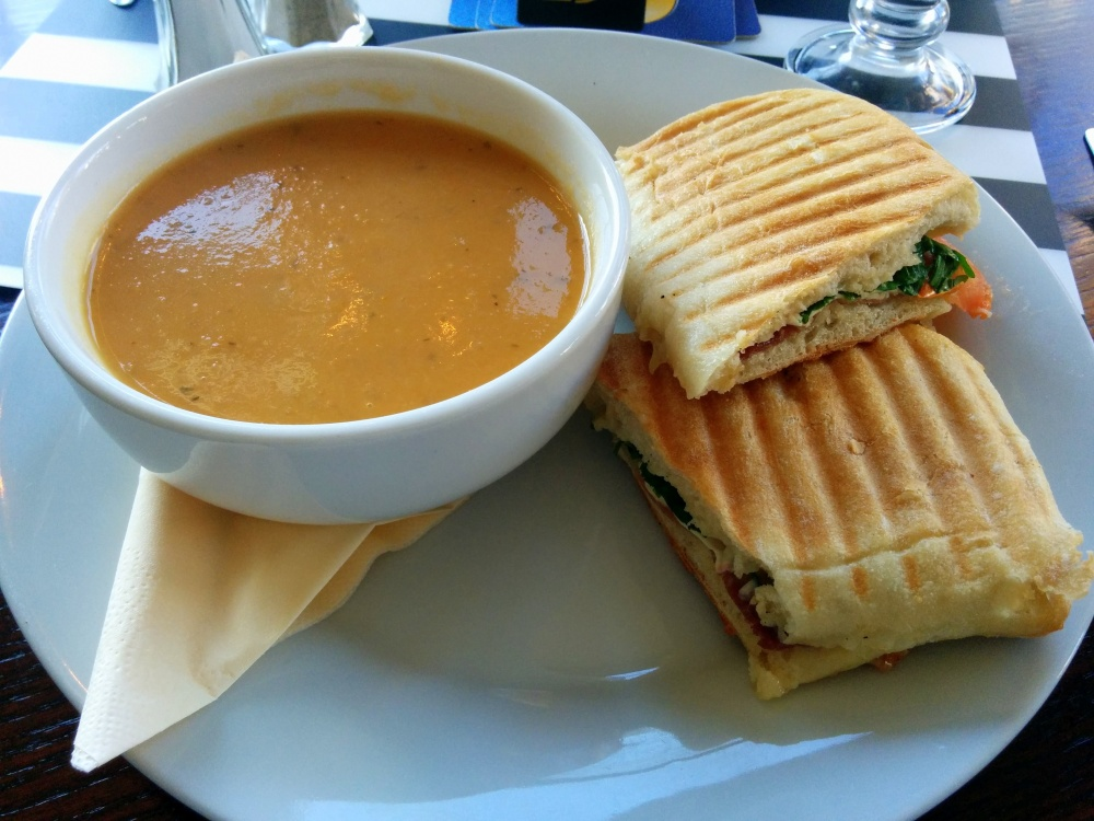 Parma ham, rocket, brie and tomato panini with vegetable broth.
